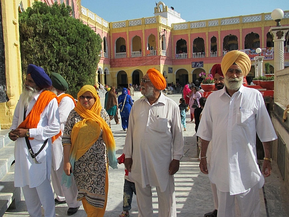 Devotees at the Punja Sahib