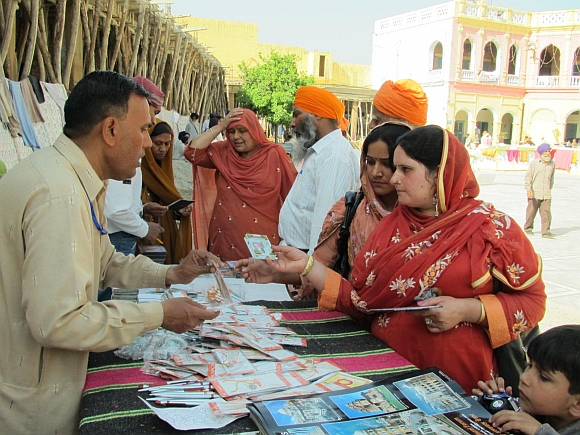 Pilgrims buying religious paraphernalia