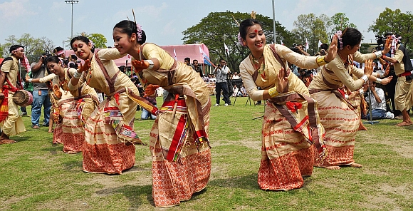 Youth in traditional Assamese attire perform Bihu dance during a programme organised to celebrate Rongali Bihu, at Judge's Field in Guwahati