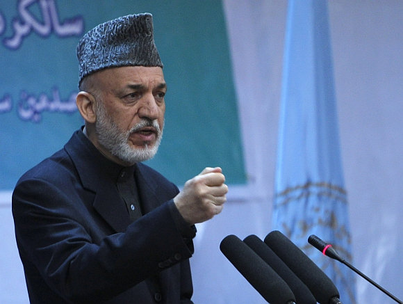 Afghan President Hamid Karzai speaks during a gathering in Kabul